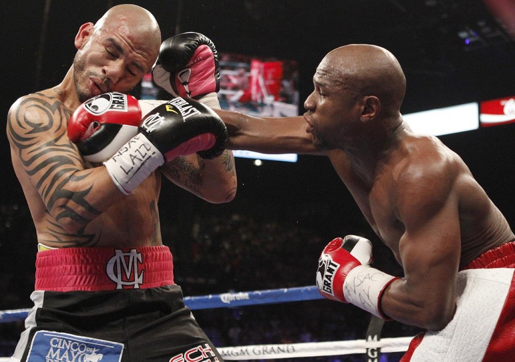 Miguel Cotto Mayweather photo