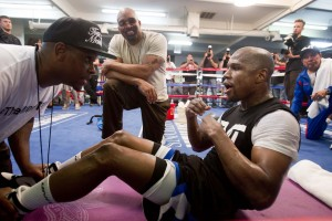 DeJuan Blake (L) helps boxer Floyd Mayweather Jr. of the U.S. with sit-ups as Leonard Ellerbe (C), CEO of Mayweather Promotions, looks on at the Mayweather Boxing Club in Las Vegas, Nevada April 17, 2013. Mayweather will defend his WBC welterweight title against Robert Guerrero, also of the U.S., at the MGM Grand Garden Arena in Las Vegas on May 4. REUTERS/Steve Marcus (UNITED STATES - Tags: SPORT BOXING BUSINESS) Picture Supplied by Action Images